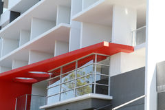 Modern Residential Apartment Block. Mostly white with red highlight, located in tropical Queensland Royalty Free Stock Image
