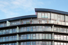 Modern residential apartment building. Photo of a luxury apartment building in London against a blue sky Stock Images