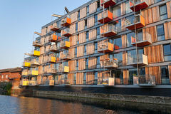 Modern residential apartment building. A block of modern apartment building alongside Regent's Canal (London) under warm sunset light stock photo