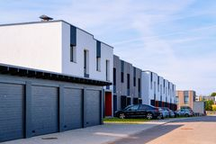 Modern residential apartment house building with garage and parking places. Modern residential apartment house building with garage and parking boxes concept royalty free stock photography