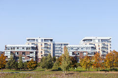 Modern residential apartment houses. Surrounded by yellow trees at autumn Stock Photography