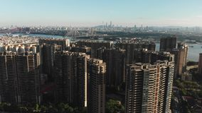 Modern residential area with a developed infrastructure on the river bank. Modern residential area with a developed infrastructure, the dprn slowly rises, the stock video footage