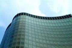Modern residential building. Modern high-rise streamline residential condominium building upward-view Stock Photos