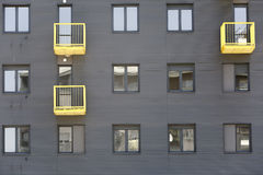 Modern residential building with yellow terraces Stock Photo