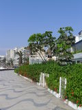 Modern residential buildings in Ancon, Lima. Lima, Peru. October 8, 2015. Ancon beach resort view of some exterior buildings at the coastline, a tiled pedestrian royalty free stock image