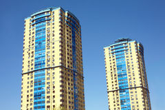 Modern residential buildings over blue cloudless sky Stock Photos
