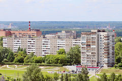 Modern residential buildings surrounded by green trees Stock Image