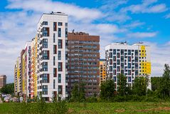 Modern residential complex on the background of the blue sky. It houses variable height from 7 to 14 storeys, built in recent year. Modern residential complex on royalty free stock image