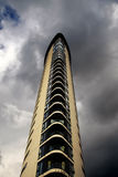 Modern residential high rise tower. Against a stormy sky royalty free stock photography