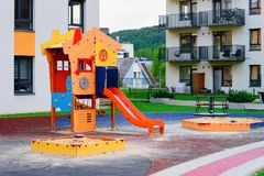 Modern residential house home apartment building exterior children playground. Modern residential house and home apartment building, exterior concept. Children royalty free stock photo