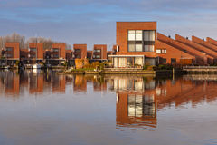 Modern residential houses on the waterfront Stock Photos