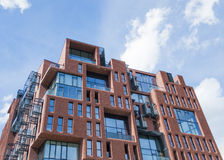 Modern appartment building. Мodern appartment building facade made of bricks and glass with small terraces Royalty Free Stock Photo