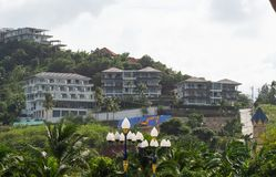 Modern resort at the hillside in the rainforest. Tropical hotel. Modern resort at the hillside in the rainforest stock photos