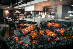 Modern restaurant with fireplace stock photography