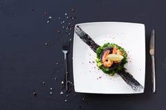 Modern restaurant food. Dorado fillet in nori with shrimps stock photos