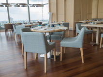 Modern restaurant of hotel with wooden furniture. And view of river royalty free stock photo