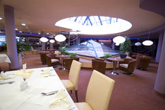Modern restaurant interior. The interior of a modern restaurant or dining room in a hotel stock images