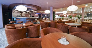 Modern restaurant interior. The interior of a modern restaurant or dining room in a hotel. Bar in the background royalty free stock images