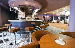 Modern restaurant interior. The interior of a modern restaurant or dining room in a hotel. Bar in the background stock images