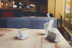 Modern restaurant interior, coffee cup on table Stock Photos