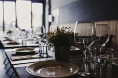 Modern restaurant interior, daytime. Food and drink industry concept. Wine glasses ready to use stock photos