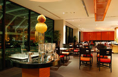 Modern restaurant interior in night illumination Royalty Free Stock Image
