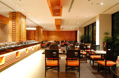 Modern restaurant interior in night illumination Stock Images