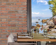 Modern restaurant interior with scenic seaside view Royalty Free Stock Photo