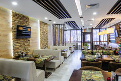 Modern restaurant interior. With tables and sofas royalty free stock photos