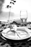 Modern Restaurant Table. A modern black and white table setting on a sunny day stock photo