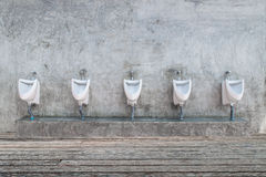 Modern restroom interior with urinal Stock Photography