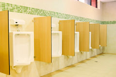 Modern restroom interior with urinal row Royalty Free Stock Photography