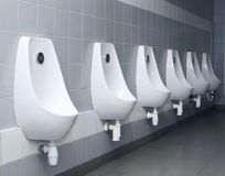 Modern restroom interior with urinal row Stock Photo