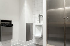 Modern restroom. Small modern men restroom with urinal Stock Photography