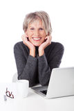 Modern retired woman with a laptop Royalty Free Stock Photo