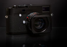 Modern retro mirrorless Digital Camera. On black background Royalty Free Stock Images