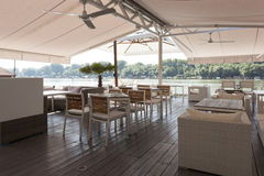 Modern riverside cafe interior in the morning royalty free stock photos