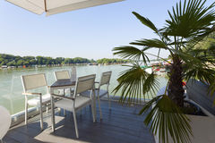 Modern riverside cafe terrace in the morning Royalty Free Stock Image