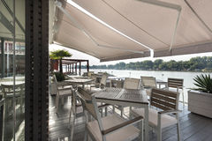 Modern riverside cafe terrace in the morning Royalty Free Stock Photos