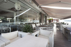 Modern riverside cafe terrace in the morning Royalty Free Stock Images
