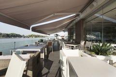 Modern riverside cafe terrace in the morning Stock Photo