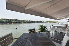 Modern riverside cafe terrace in the morning Stock Images