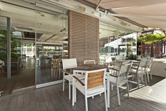 Modern riverside cafe terrace in the morning Royalty Free Stock Photo
