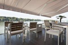 Modern riverside cafe terrace in the morning Stock Image