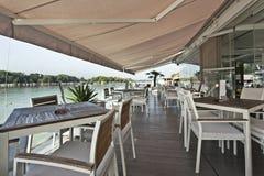 Modern riverside cafe terrace in the morning stock photos