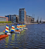 Modern riverside development. Modern dock side development with sailing boats in the foreground Royalty Free Stock Photos
