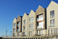 Modern riverside flats. In line stock photography