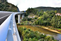 Modern road bridge over river Brazo Mayor flowing into the Cantabrian sea in San Vicente de la Barquera Royalty Free Stock Images