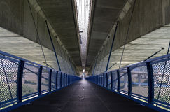 Modern road junction and Pedestrianized road is beneath motorway. Royalty Free Stock Photography