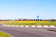 Modern road and roundabout in rural England Royalty Free Stock Photo